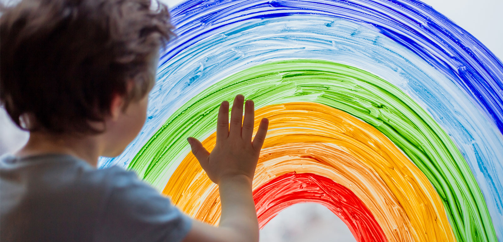 boy painting a rainbow